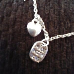 Jewelry - A silver ankle bracelet.